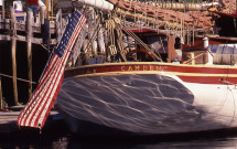 Flag tied to stern of Camden sailboat