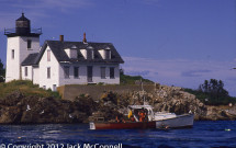 Lobster boat working in front of Indian Island Lighthouse