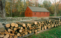 Thompson red barn with wood pile